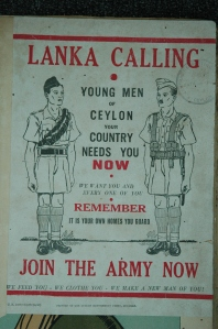 A Second World War recruitment poster from Ceylon, reminiscent of the famous First World War poster showing Field Marshal Lord Kitchener demanding the viewer to join up.